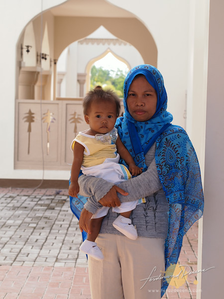 A Mother and Child at the Grand Mosque