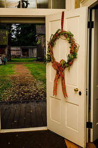 Christmas wreath on the front door of the factor's home.