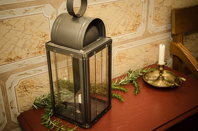 A lantern and a little greenery makes a simple Christmas decoration.