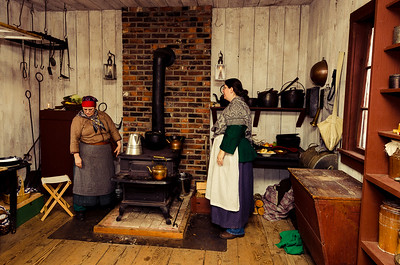 Kitchen workers around the wood stove.