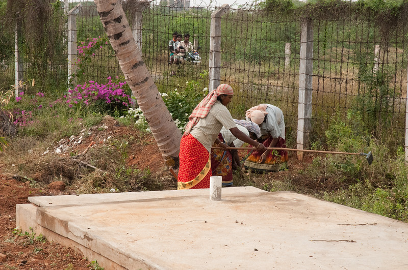 LiveWell is only 18 months old, and there is much landscape work underway. These local women wear saris while doing heavy garden work.