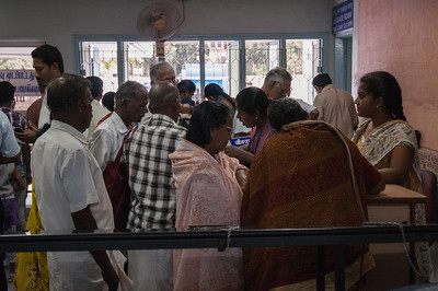 Patients checking their luggage at the entry to Aravind Hospital.