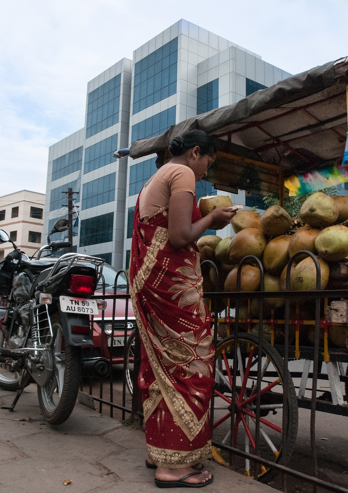 Coconut juice on sale along the street; behind is the Aravind research building.