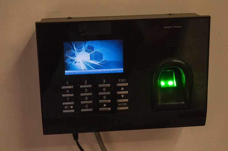 Staff punch-in using this thumbprint scanner.