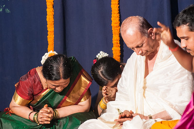 Rima, with mother and father, receiving blessings.