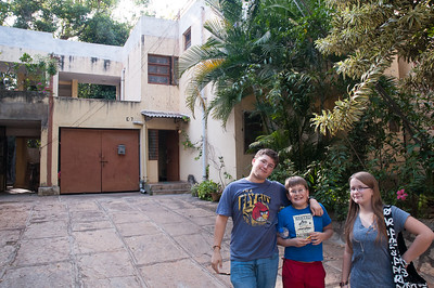 John, Andy, and Mara pose in front of our old apartment.