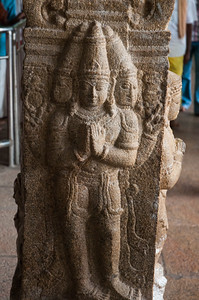 The three-headed god represents Shiva, Vishnu, and Parvati.
