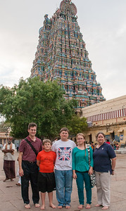 Family portrait with one of the main towers. Madurai, India.