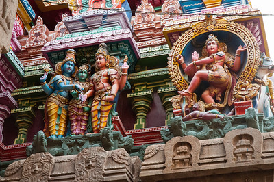 Detail on the West tower: at left, Vishnu, Parvati, and Shiva; at right, dancing Shiva.
