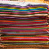A rainbow of wool shawls.