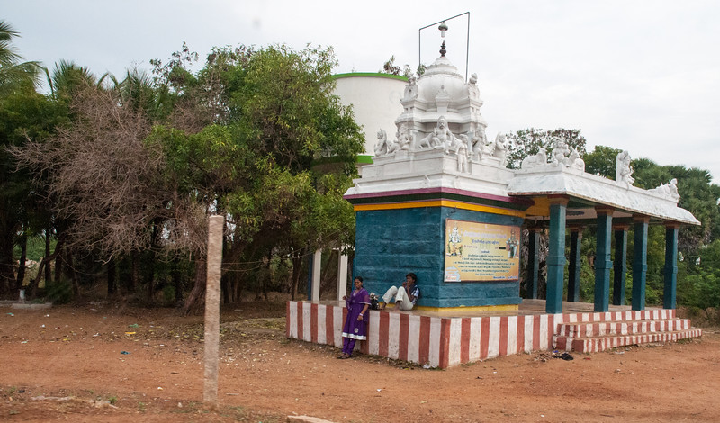 One of the many small roadside temples outside Madurai. The red & white stripes signify Shiva and Parvati.