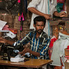 One of the many men with foot-powered sewing machines making clothing to order, in the market near the temple.