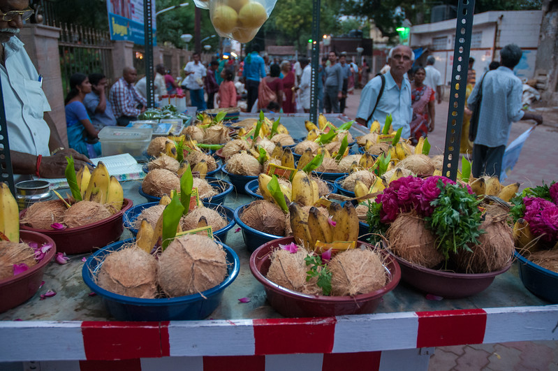 A vendor sells traditional offerings for people to bring to the goddess inside the temple.