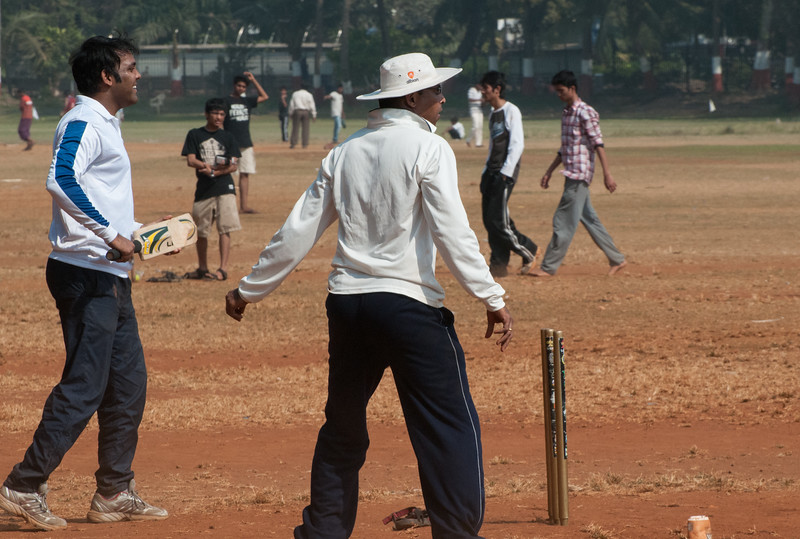 At the Oval Maidan, dozens of cricket matches underway; two formal matches and many informal matches such as this one.