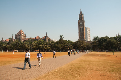 The Oval Maidan - full of cricket players on weekends - with the Rajabai Clock Tower at center and High Court at left.