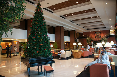 Main lobby of the Trident Hotel, decorated for Christmas.