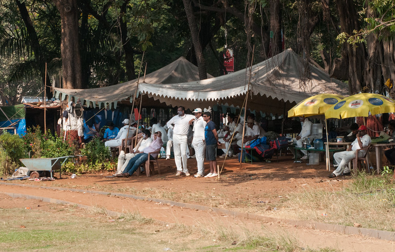 At the north end of Oval Maidan, sidelines for a serious cricket match underway.