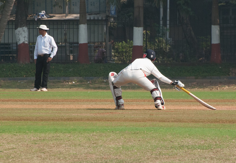 The batsman tagging off at the opposite wicket.