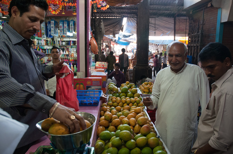 """We buy mangos at Crawford Market; the old man at center adopted us and took us around the market place; he called himself """"Papa""""."""