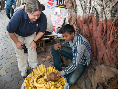 Pam stops to buy fresh bananas. So much tastier than at home!