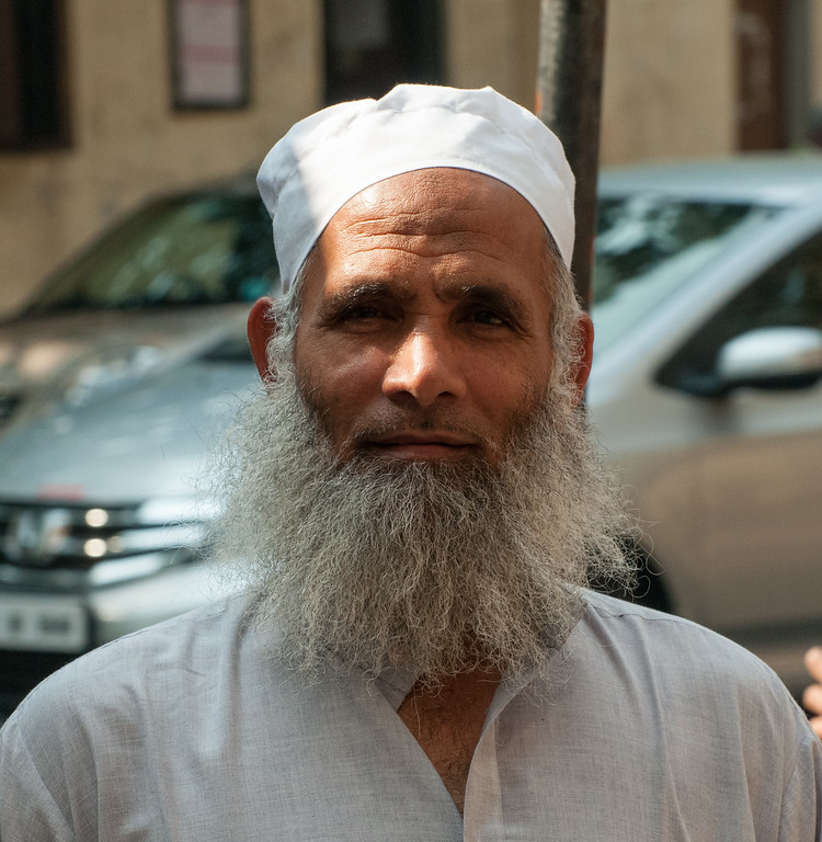 This old man stopped me on the street and asked me to take his photo.