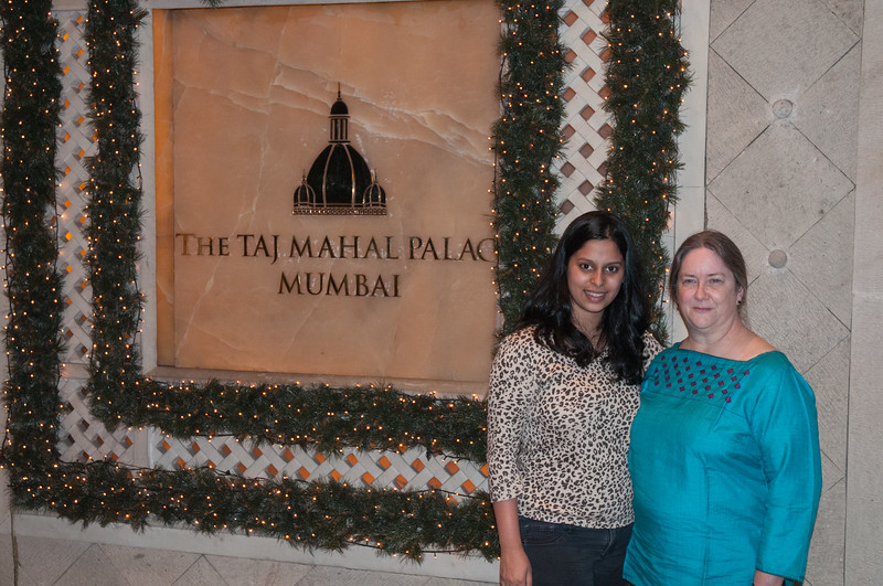 Pam with Kirti in front of the Taj Palace Hotel.