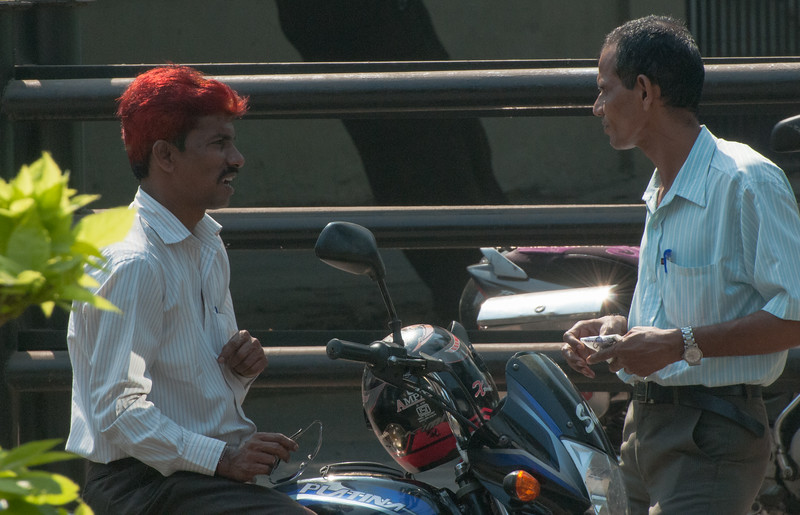 Orange hair, a not uncommon fashion, is made I think by washing henna into the hair.