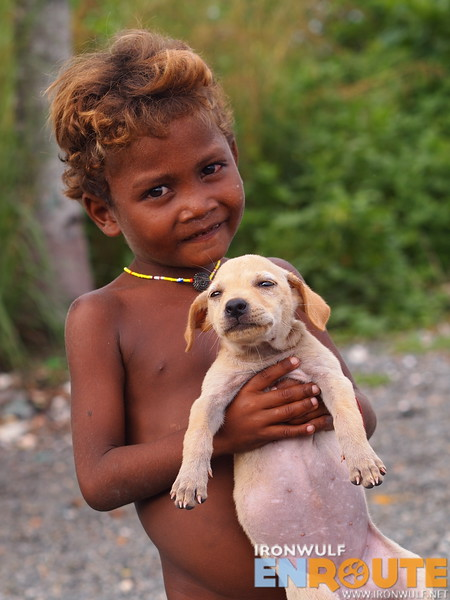 A Dumagat kid with his pet dog