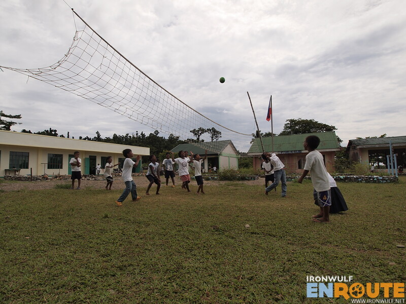 A friendly volleyball game at Reina Mercedes school