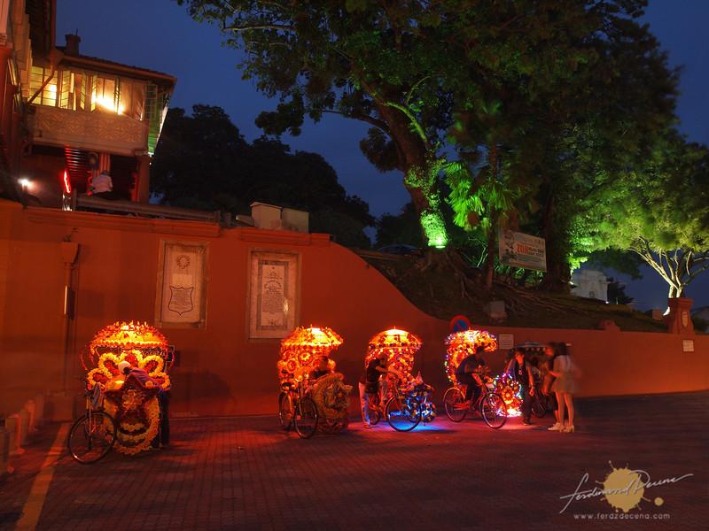 Blinking lights at the bicycle rickshaws in Melaka