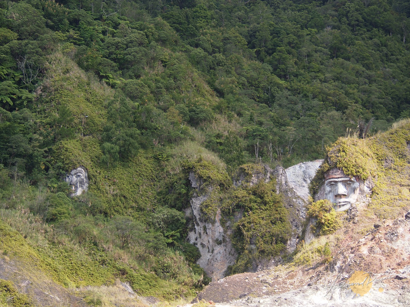 The faces of Toar and Limumuut, the Minahasa Tribes ancestors carved on a hill