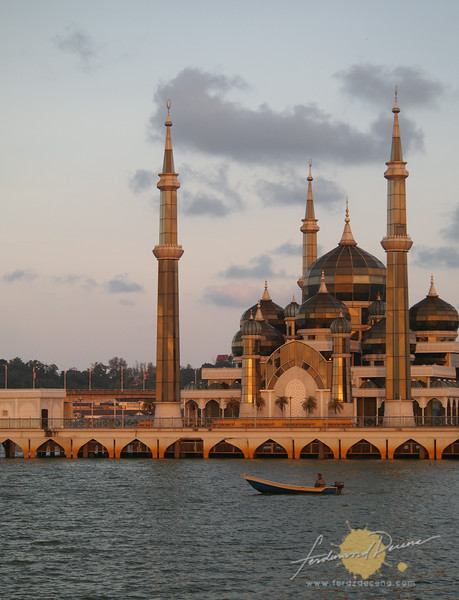 From afar, the mosque seems to float on the river