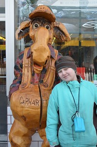 My grand-daughter, Savanah, poses with a wooden moose in downtown Anchorage.