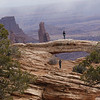 Brave girl to stand out on the Mesa Arch