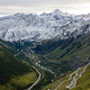 Here's a brief testament to the overall craziness of Swiss roads through the mountains. Shown from halfway down Furkapass, with the rise to Grimselpass in the distance.