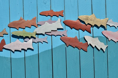 Decorative fish on the fence around a dumpster in Westport, WA