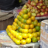 Oranges and apples for sale - street vendor