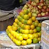 Oranges and apples for sale - street vendor