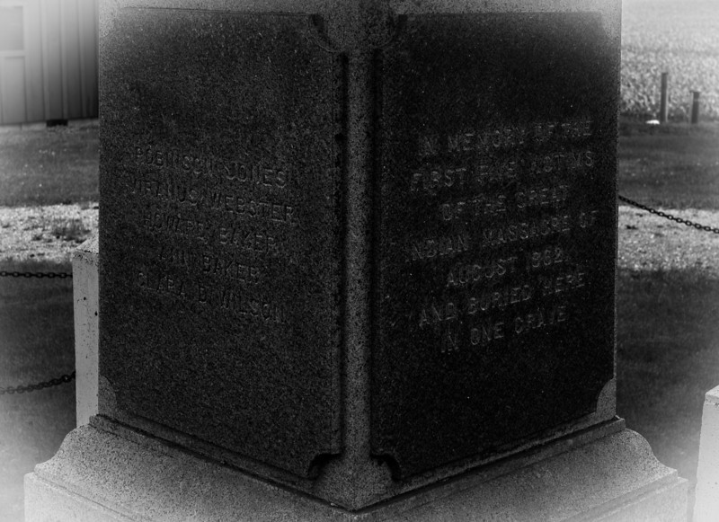 """Crop developed to be readable. The list on left is five names. On the right it says """"In memory of the first five victims of the great massacre of August 1862 and here buried in one grave. I read the article on it and this is definitely one way of looking at it (grammar aside)."""