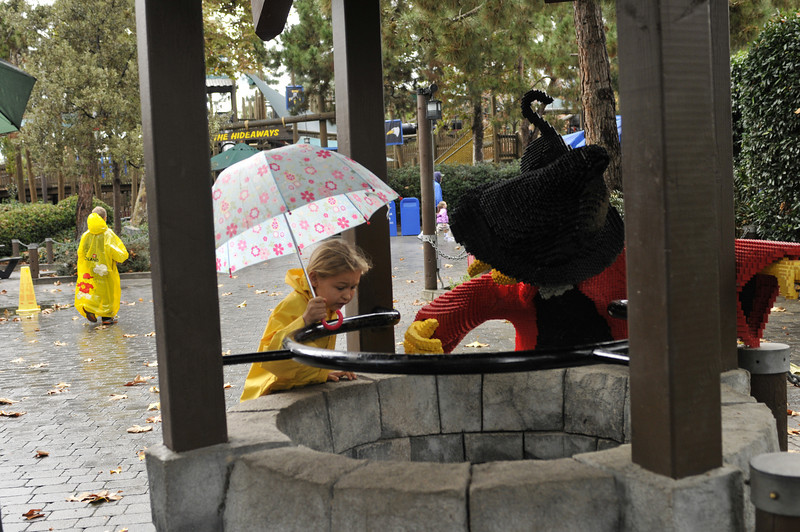 There are a lot of sculptures made with regular Legos. Here Quinn looks down a well with a Lego witch