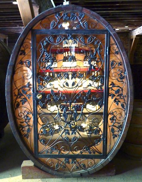 Intricate wrought iron wine cellar.