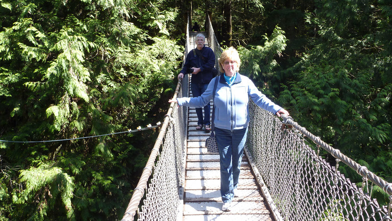 Daphne & friend Ron on the Lynn Valley suspension bridge, north Vancouver. About 200 ft above a roaring river