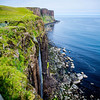 Kilt Rock, a dramatic 200 foot-high cliff marked in an almost tartan-like pattern by rock strata, and a waterfall cascading down to the pebbled shore below.