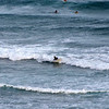 Images of surfers from top of sheer cliff