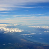 Molokai in the foreground - Maui's  Haleakala volcano  in middle-left and Hawaii's Mauna Kea & Mauna Loa in distance