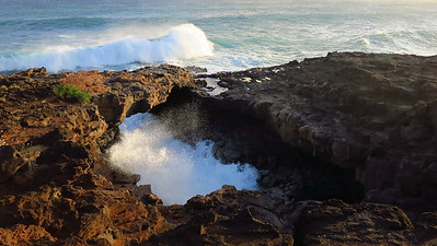sea arch near the Point at Poipu