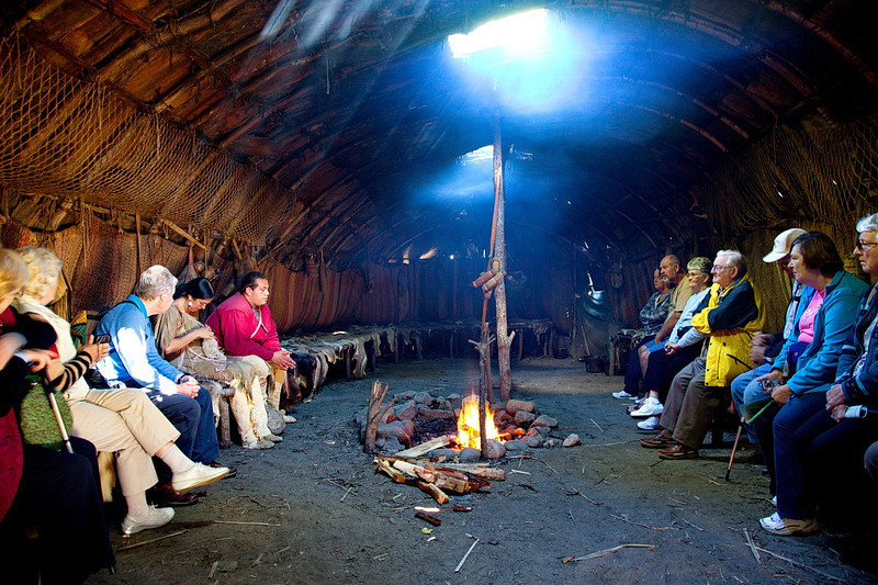 4355 Visitors in a period house listen to a Native-American docint (the woman to the left of the man in the red shirt) explaining the life and times of the Wampanoag people native to the Plymouth, MA, area.