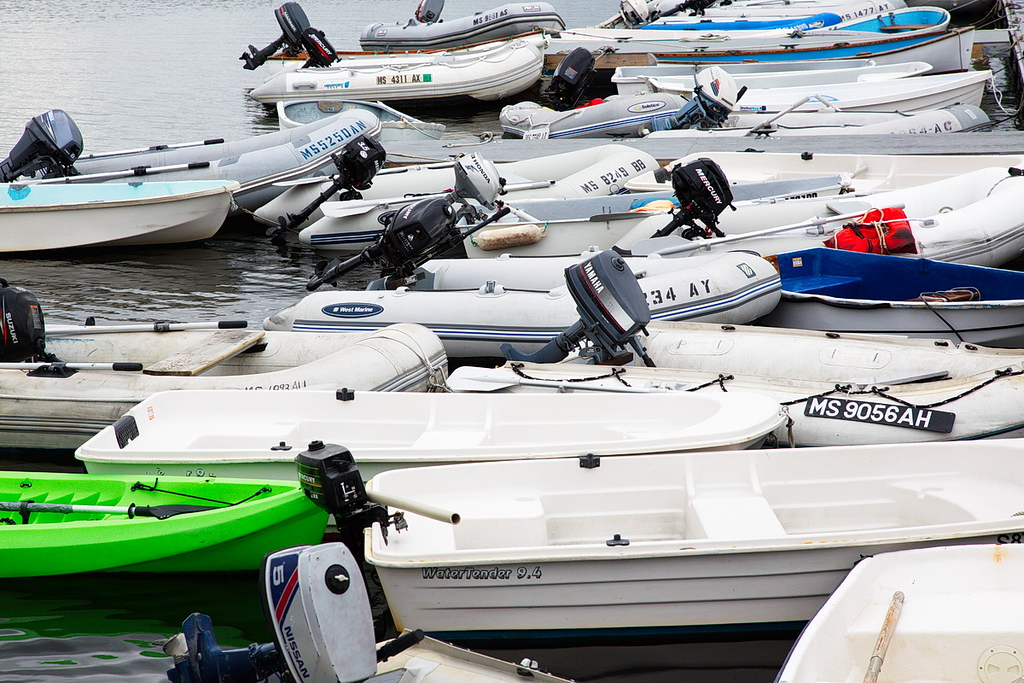 89 A collection of dinghy's, looking a lot like sardines in a can, at a dinghy dock in Provincetown Harbor,.