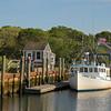 A fishing boat docked in Saquatucket Harbor, Harwich Port, Cape Cod, Massachusetts