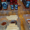 There were many hot sauces to taste, numbered in heat from 1-10.  This one was special.  The caption says: ASK FOR ASSISTANCE.  PLEASE SIGN WAIVER BEFORE SAMPLING HOTTEST SAUCE IN THE UNIVERSE.  2ND DIMENSION.  MUST BE 18 TO SAMPLE SAUCE.  EXTREME HEAT.  10+++